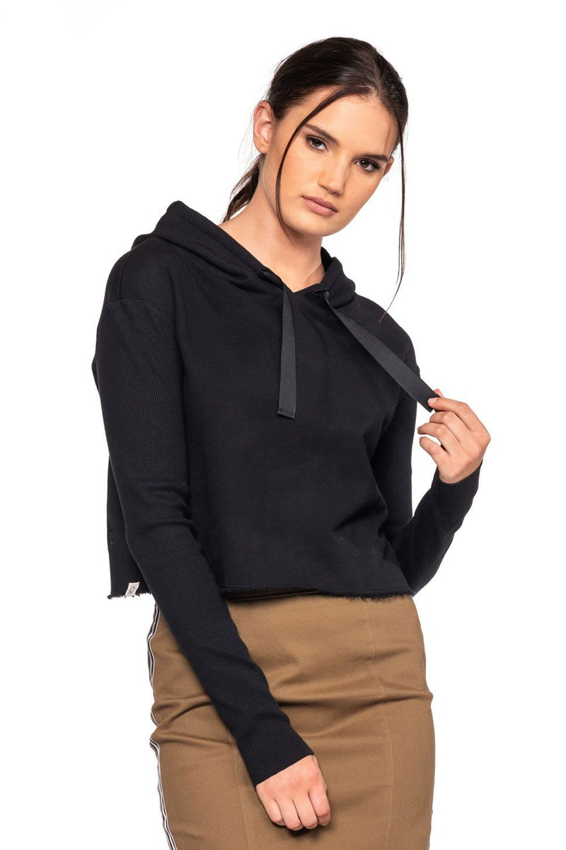 "One model on a white background wearing a ladies designer French terry hoodie in black embroidered with ""Love Over H8"" at the back hem."