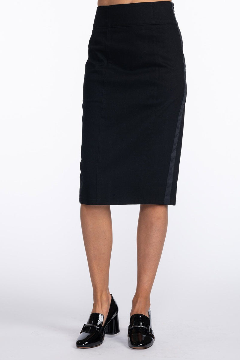 One model wearing a ladies stretch twill pencil skirt in black with black side stripe on a white background.
