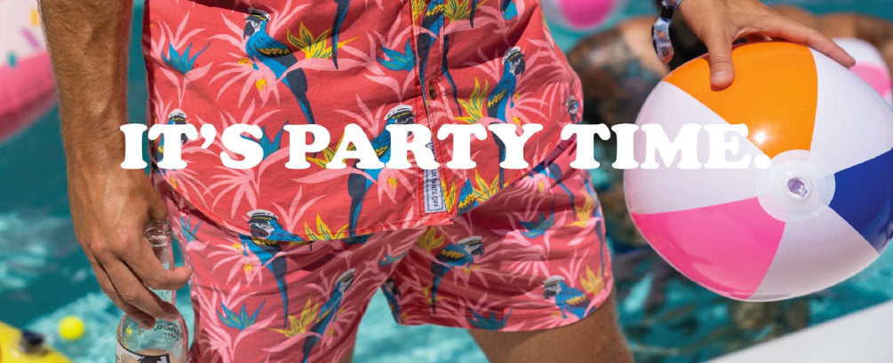 Shop Party Pants' collection of swim shorts and tops. Man wearing matching shorts and top in a pool, holding a beer