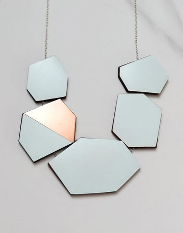 geometric statement necklace in copper and green formica