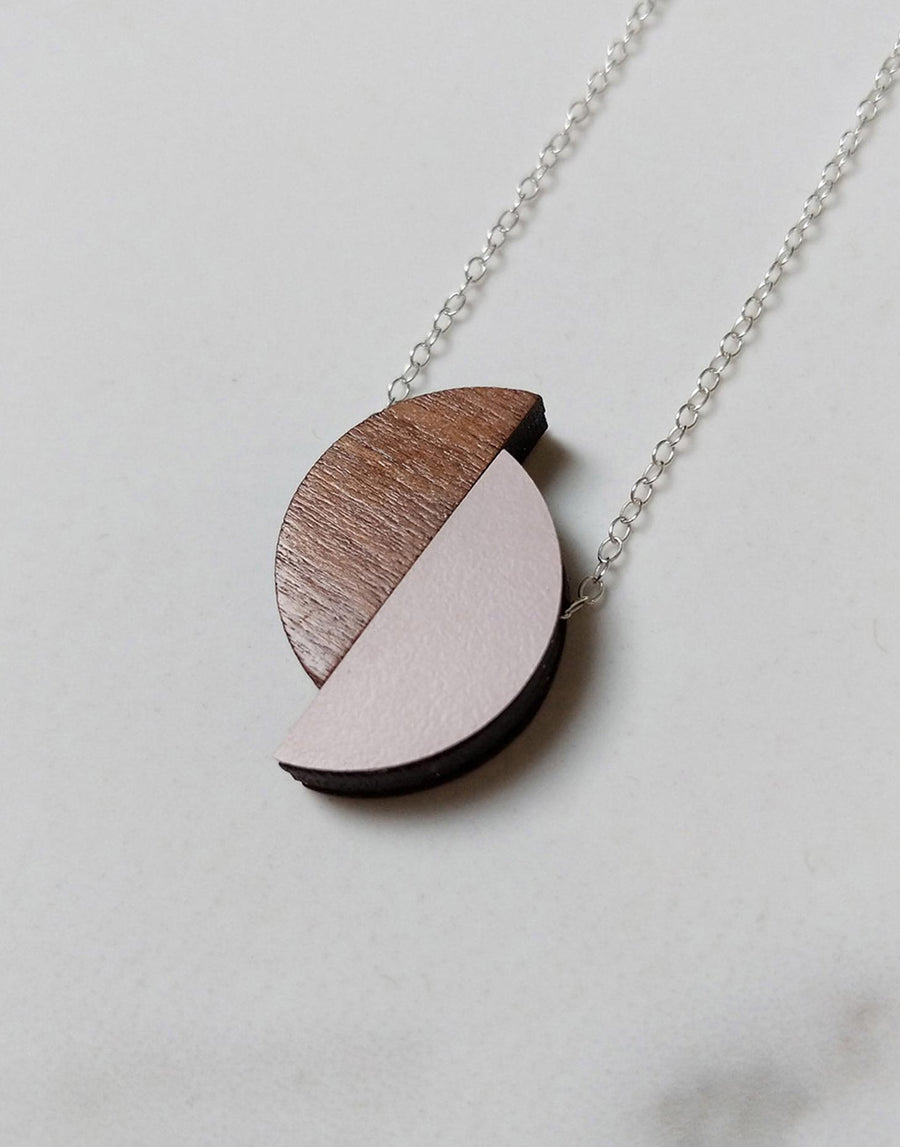 pink formica and walnut wood semi circle necklace close up