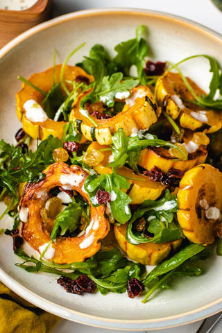 Delicata squash local to New England on a salad