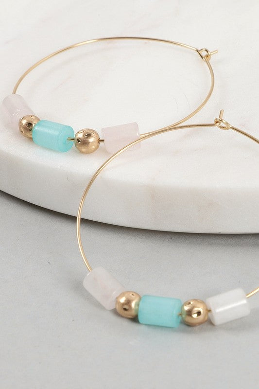 Circular earrings with stone and beads