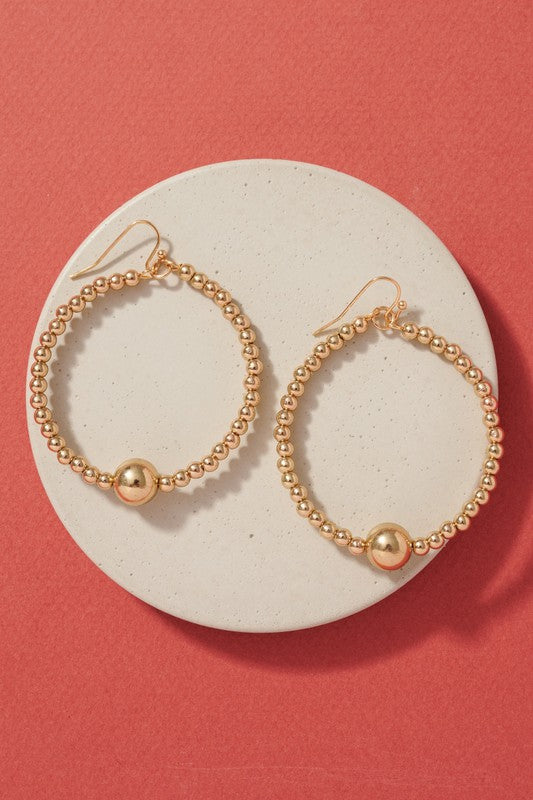 Hoop earrings with metal beads