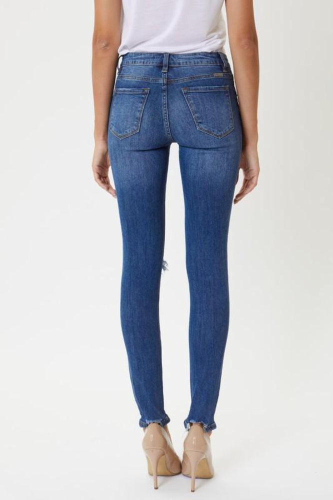 Mid Rise Destressed Super Skinny Jeans