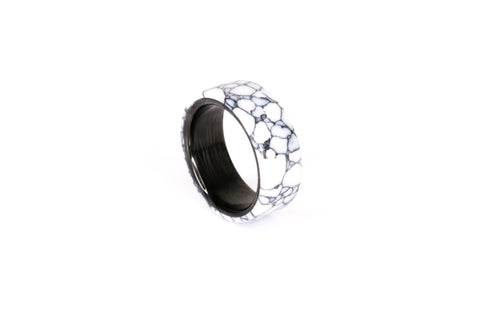 A trustone ring made from black and white marble trustone and carbon fiber by Carbon Fi