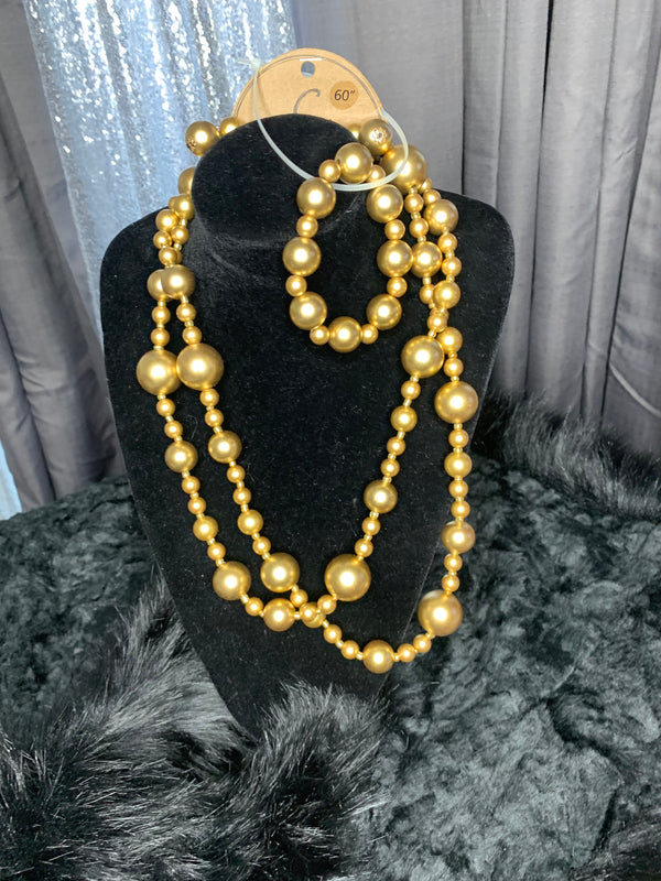 Pearl necklace, bracelet and, earrings set