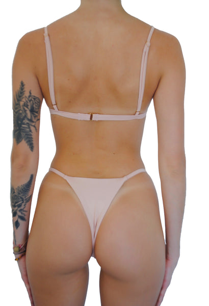 We all need this little string bikini in our collections. The Blaze Bottom offers multiple different styling options from wearing the straps above your hips in BayWatch fashion or lower for a more classic look. Our signature V-cut front gives the Blaze its one-of-a-kind style. The classic string bikini perfected