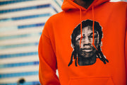 Lifestyle photo of Meek Mill's red docket hoodie found on MeekMill.com