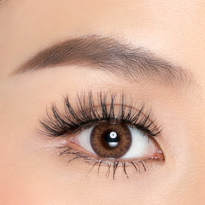 Close eye shot of model wearing Petite Cosmetics Daisy lashes from the Luxe Faux Mink Collection