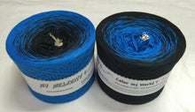 "Wolltraum My Melodyy ""Color My World 7"" Gradient Ombre Yarn Cake  Colors: Sea Blue-Black  Light Center: Sea Blue  Dark Center: Black  50% Cotton 50% Acrylic"