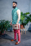 Mens ARJUN Turquoise Vest with Floral Embroidery and Gold Buttons - Side View - Harleen Kaur