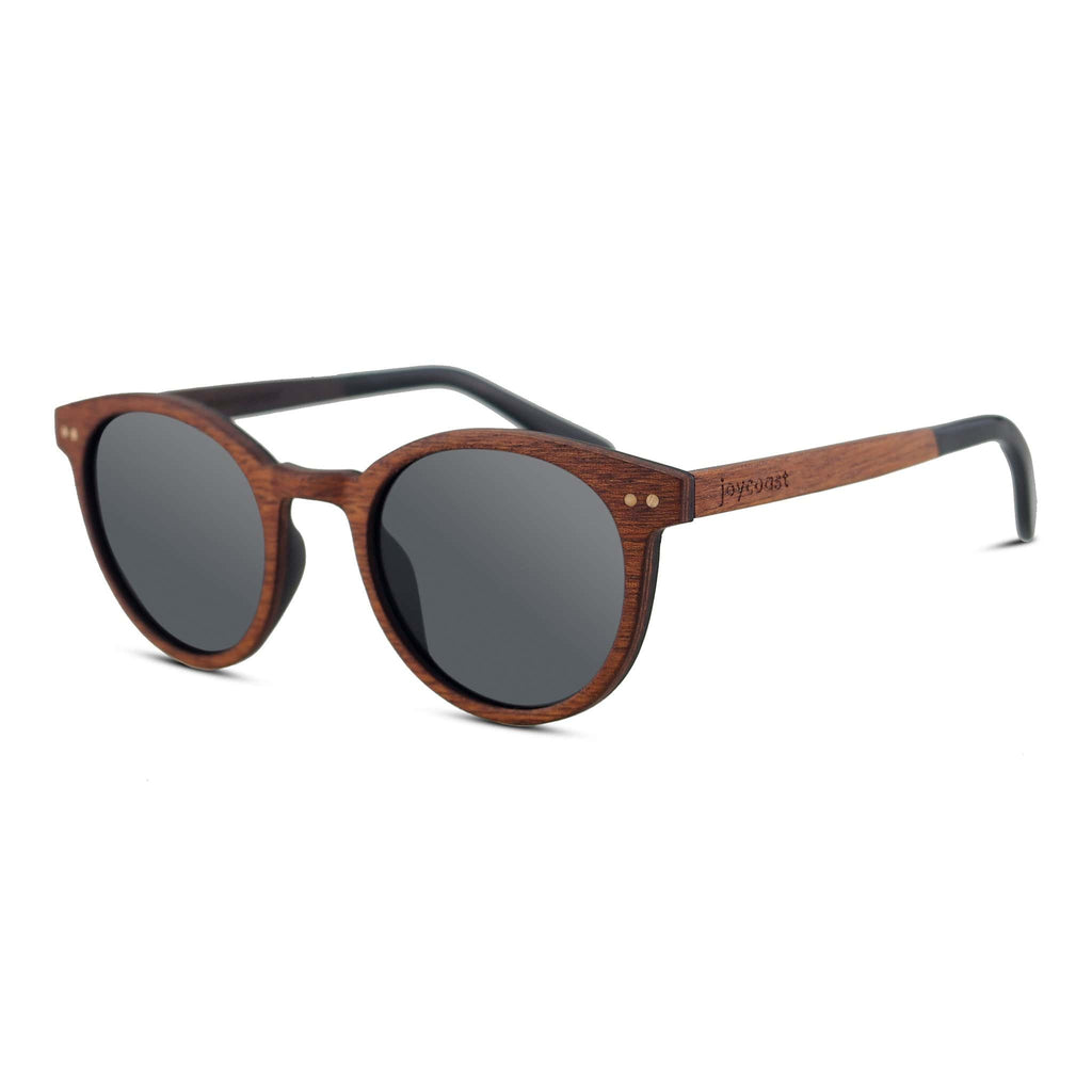 Joycoast Round Sunglasses made from Walnut wood. A mid tone wood. This photo features grey lens with acetate ear pieces on the arms.