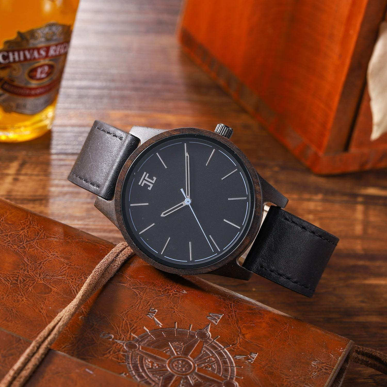 dark wooden watch sitting on table