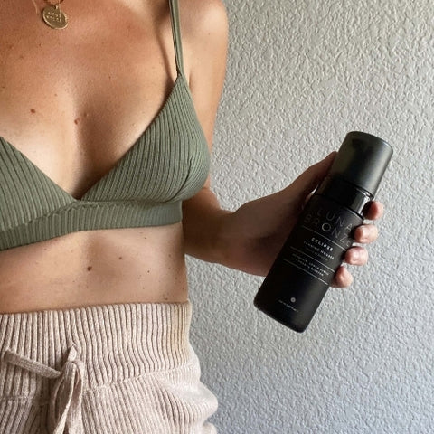 Eclipse Tanning Mousse being held and showing results