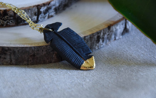 Black porcelain gold tipped feather