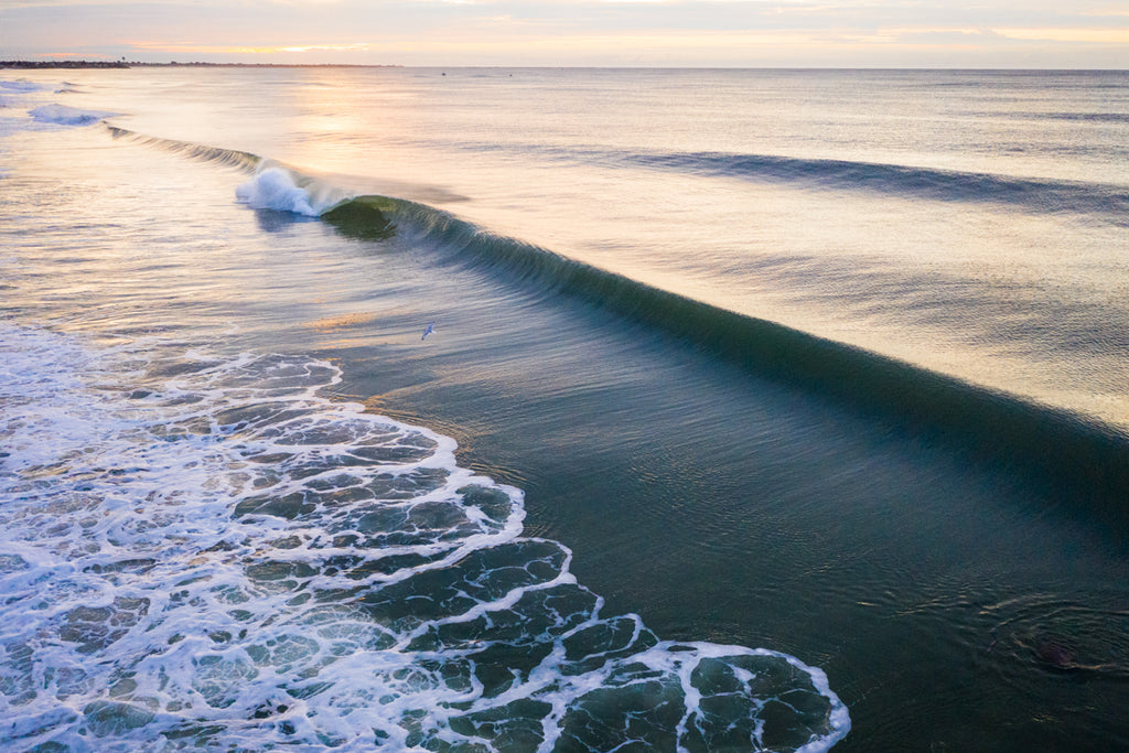 Sunrise Surf Aerial by Cate Brown