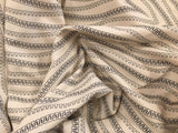HALF YARD - 95/5 Cotton/Spandex Jersey - Abstract Zippers on Cream
