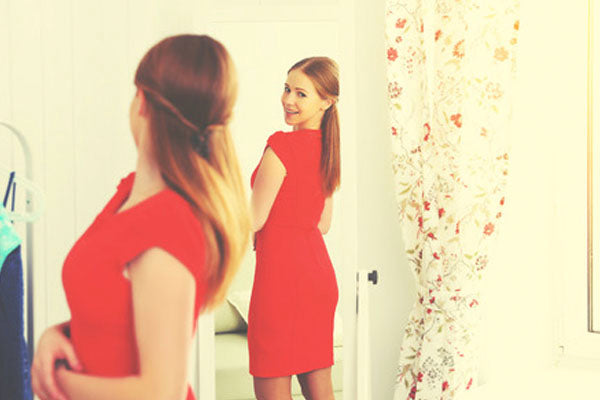 woman mirror red dress