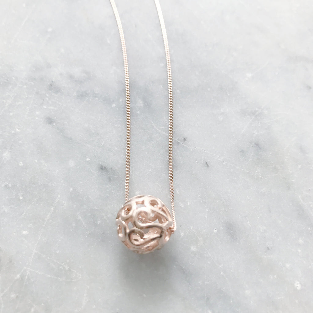 Rose gold sterling silver ball pendant