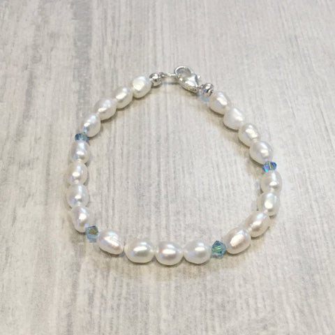 Ivory freshwater cultured pearl bracelet with blue swarovski crystal elements