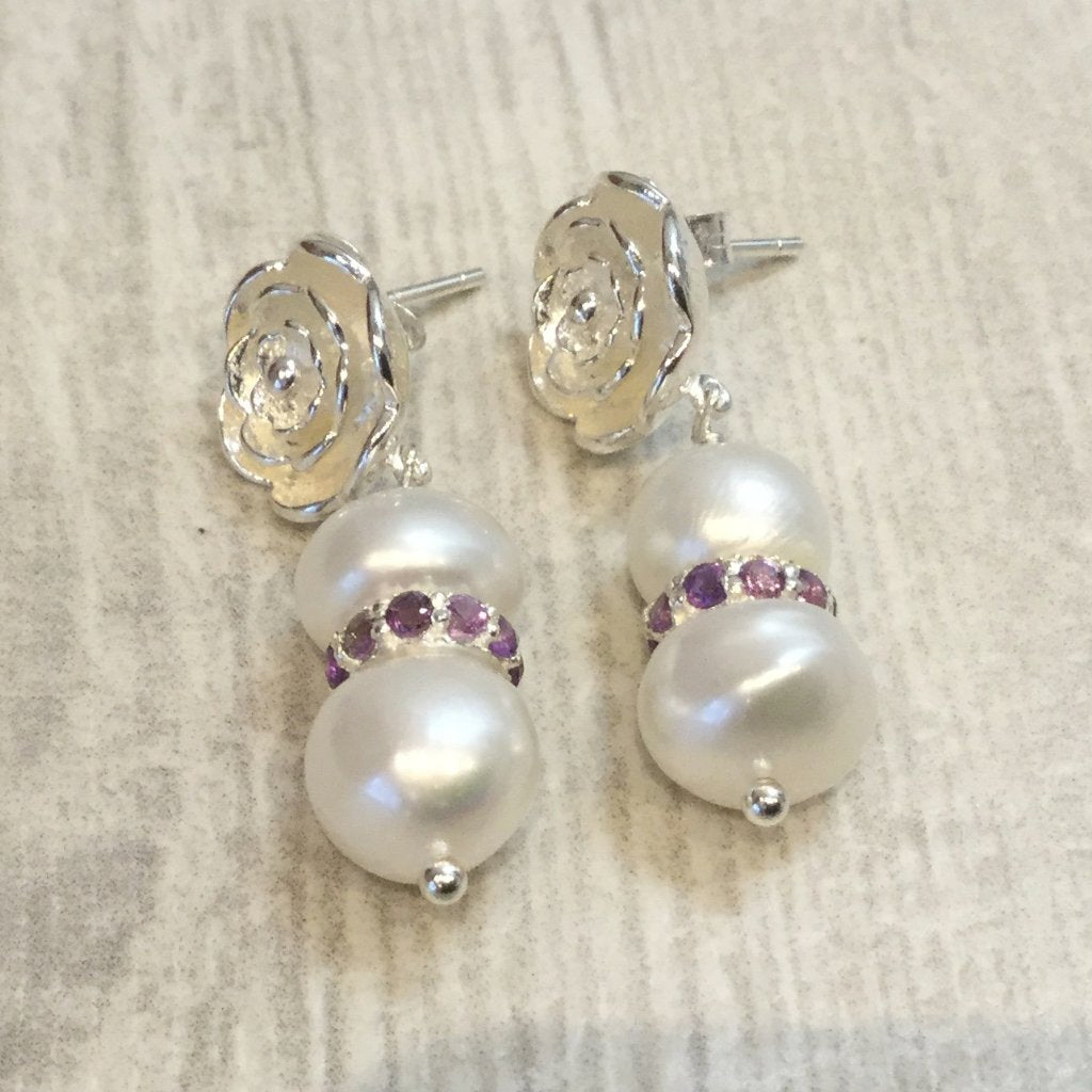 Ivory freshwater cultured button pearl earrings with amethyst