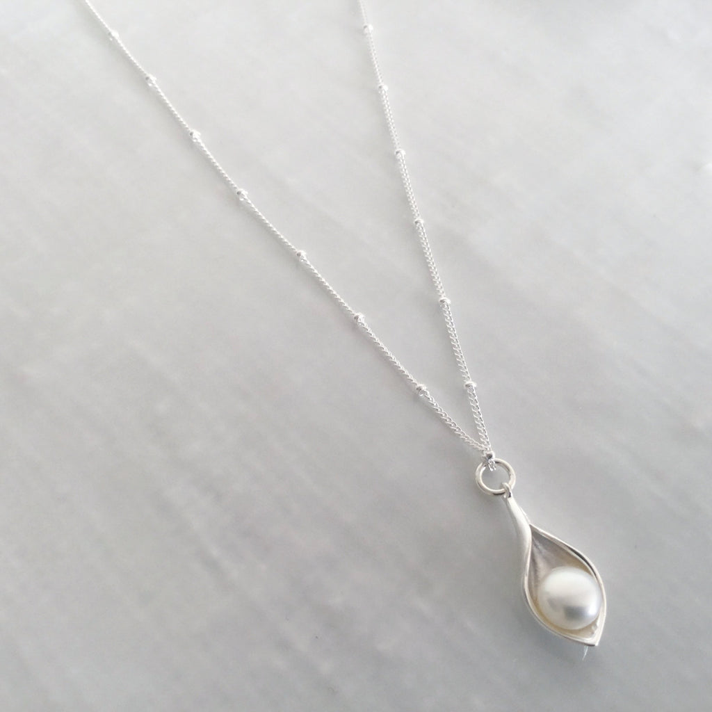 Calla lily pendant with freshwater cultured pearl