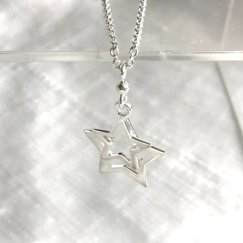Double cut out sterling silver stars necklace
