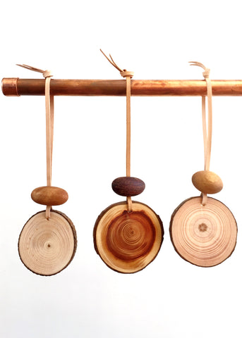 Natural timber slice wall hanging with natural leather and timber bead for essential oils