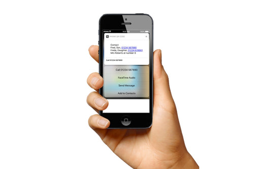 hand holding an iphone displaying results