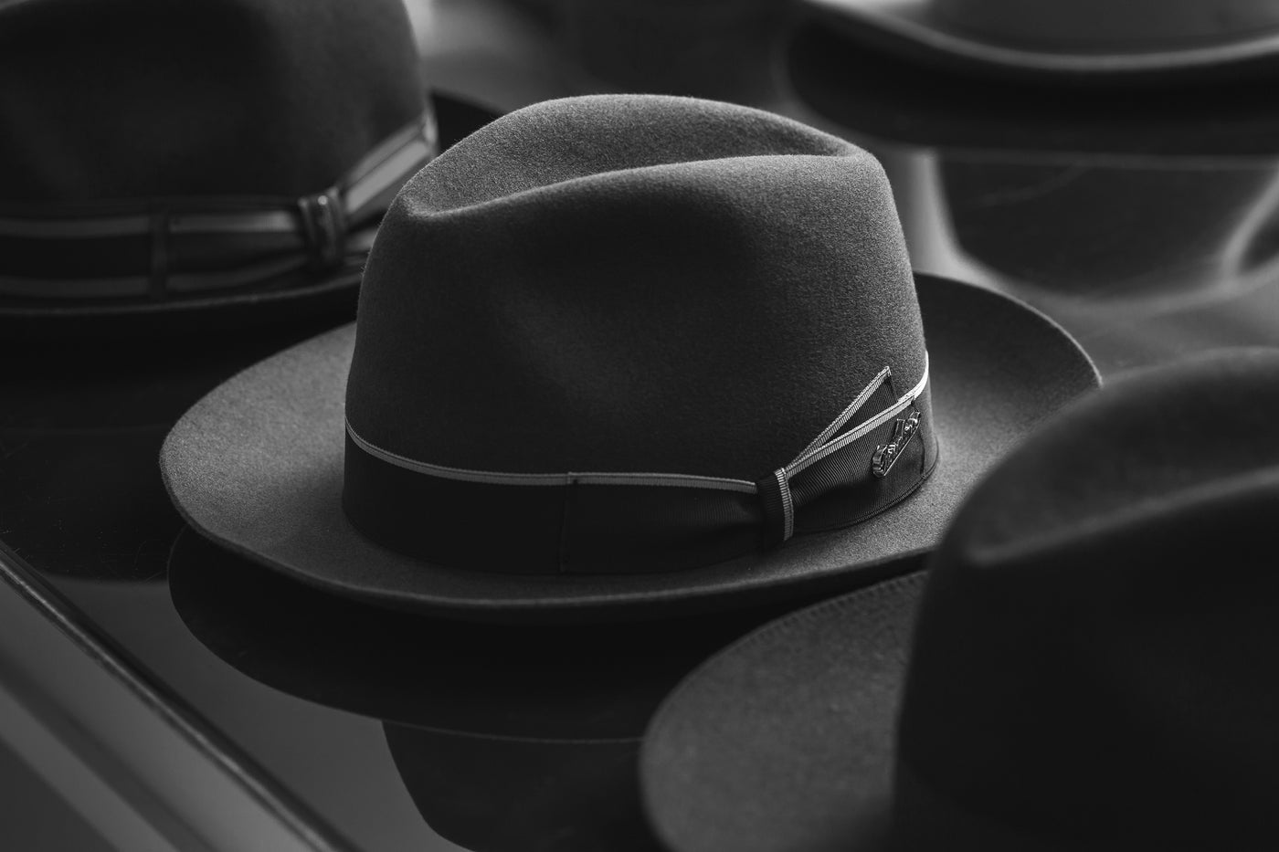 Borsalino for Atica fedora hats for men in black and white.