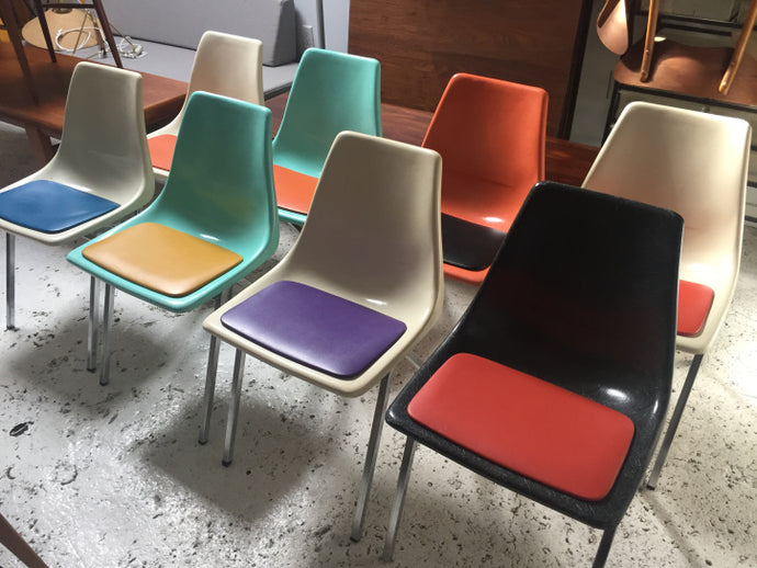 8 Fibreglass and Vinyl dining chairs.