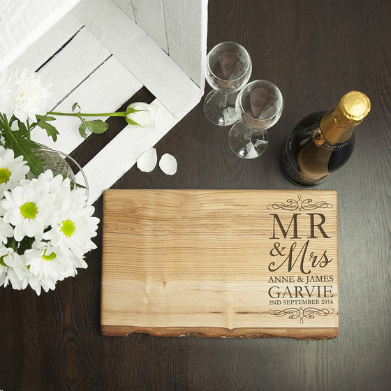 Ash serving board displayed with flowers and champagne