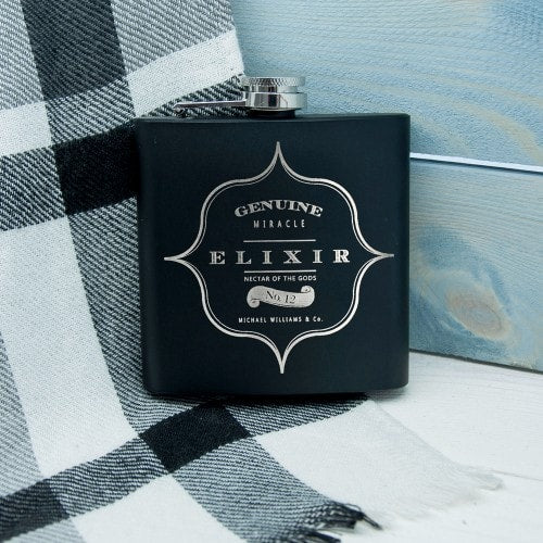 Hipflask with elixir written across the center and name