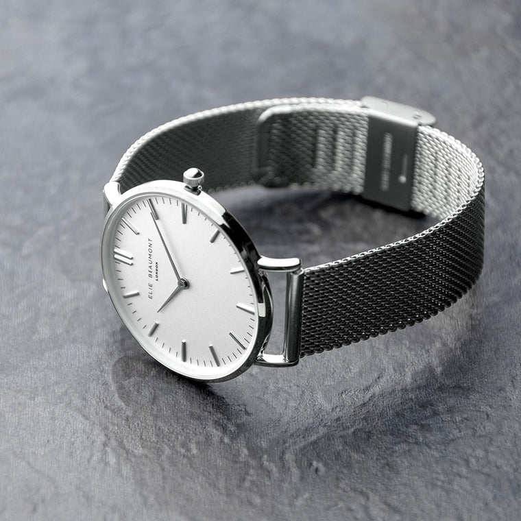 watch and chrome wristband displayed