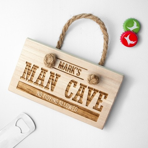 rectangular wooden man cave sign with rope hanger