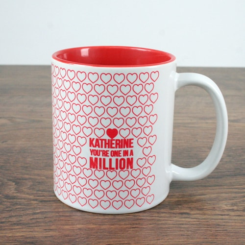 white mug with red inner and red design with one in a million