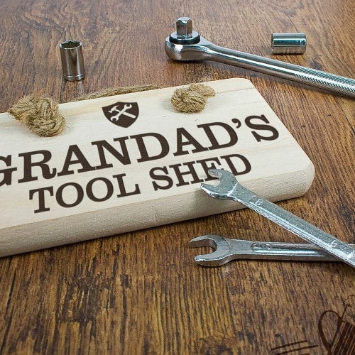 rerectangular wooden sign with rope hanger with grandads tool shed etched