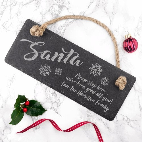 personalised slate sign with rope hanger saying santa stop here