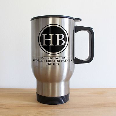 Tall silver travel mug with black handle top and base. Two initials of the recipients displayed in the centre.