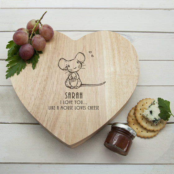 heart shaped wooden cheeseboard with mouse design in the centre.