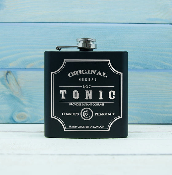 black matt hipflask with tonic emblem design and name