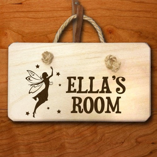rectangular wooden childrens bedroom sign with fairy and ella's room etched