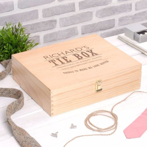 wooden box personalised with 'tie box' and a message on the front