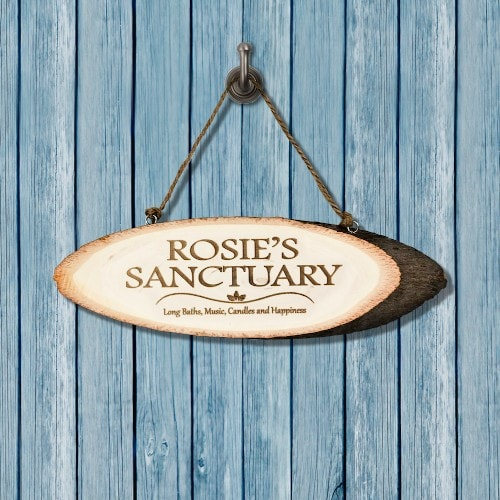 wooden oval sign on string Rose's sanctuary