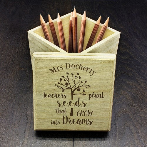 wooden teachers box with inscribed lid and pencils stored inside
