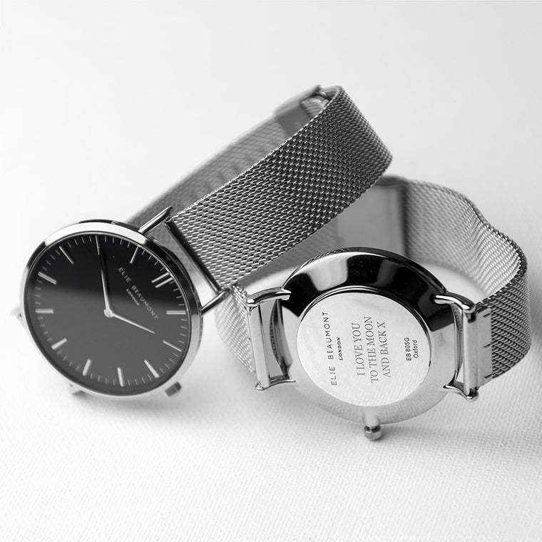 front and back of chrome watch with personalisation