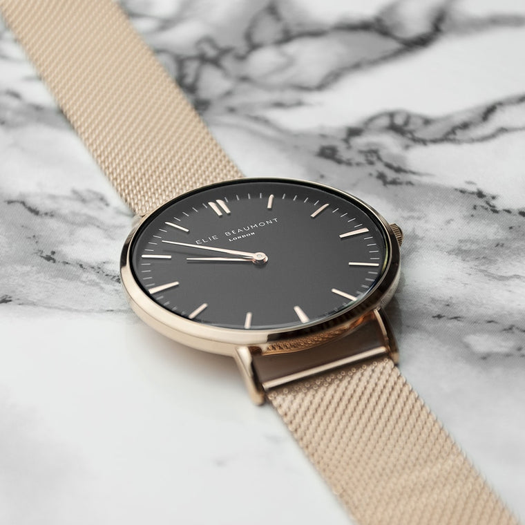 watch in rose gold with black dial