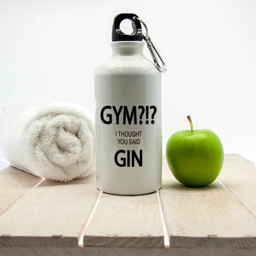 white metal water bottle with gym gin saying with apple and towel