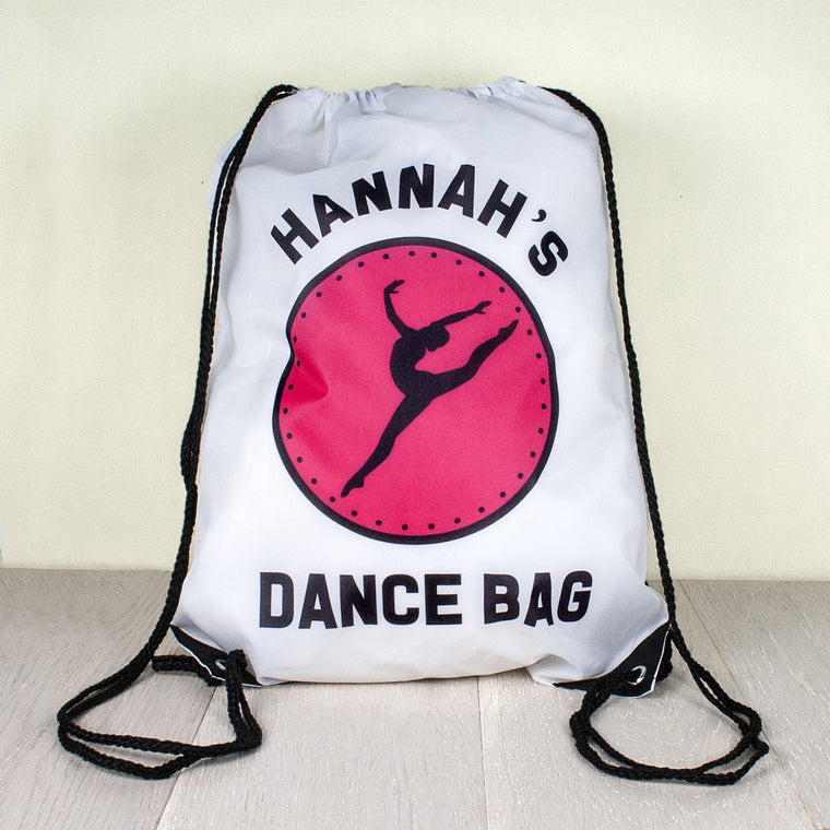 White Nylon Kit Bag with black drawstring and pink circular logo depicting a Dance movement and name of recipient and Words 'Dance Bag' on the front.